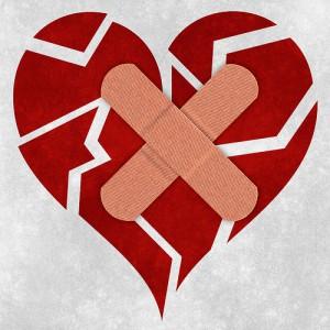 Image of a bandaged and hopeless broken heart shape