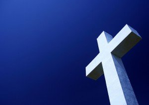 Photo of a Cross with blue sky in the background