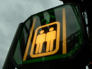 Photo of a sign depicting two generic male images
