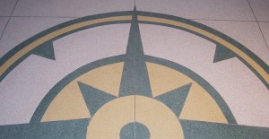 Photo of floor tiles colored to look like a decorative map compass