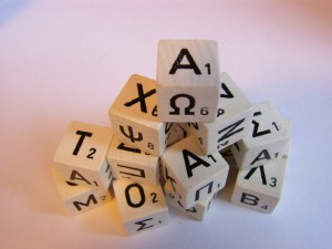 Photo of dice with Latin and Greek letters on them
