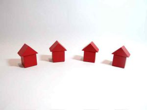 Abstract photo of four little houses next to each other